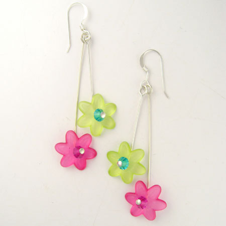 Two translucent Lucite flowers, one pink and the other green, with sparkling Preciosa crystal centers drop from sterling silver ear wires. The green flower is slightly shorter than the pink flower. The earrings are approximately 1-3/4 inches long from the bottom of the ear wire.