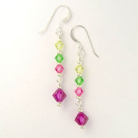A column of Preciosa crystals in pink, green and yellow hang from sterling silver ear wires. The earrings are about 1-1/4 inches long from the bottom of the ear wire.