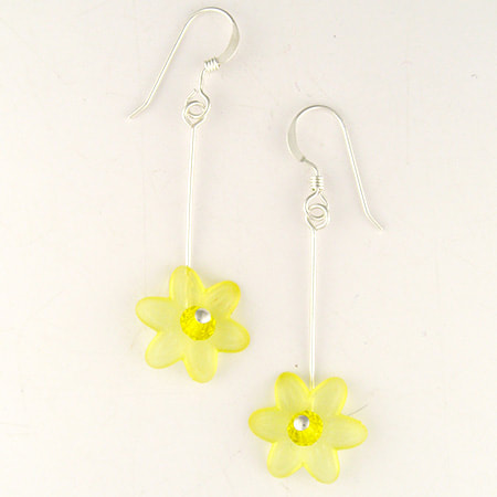 A translucent yellow Lucite flower with sparkling Preciosa crystal center drops from a sterling silver ear wire. The earrings are approximately 1-1/4 inches long from the bottom of the ear wire.